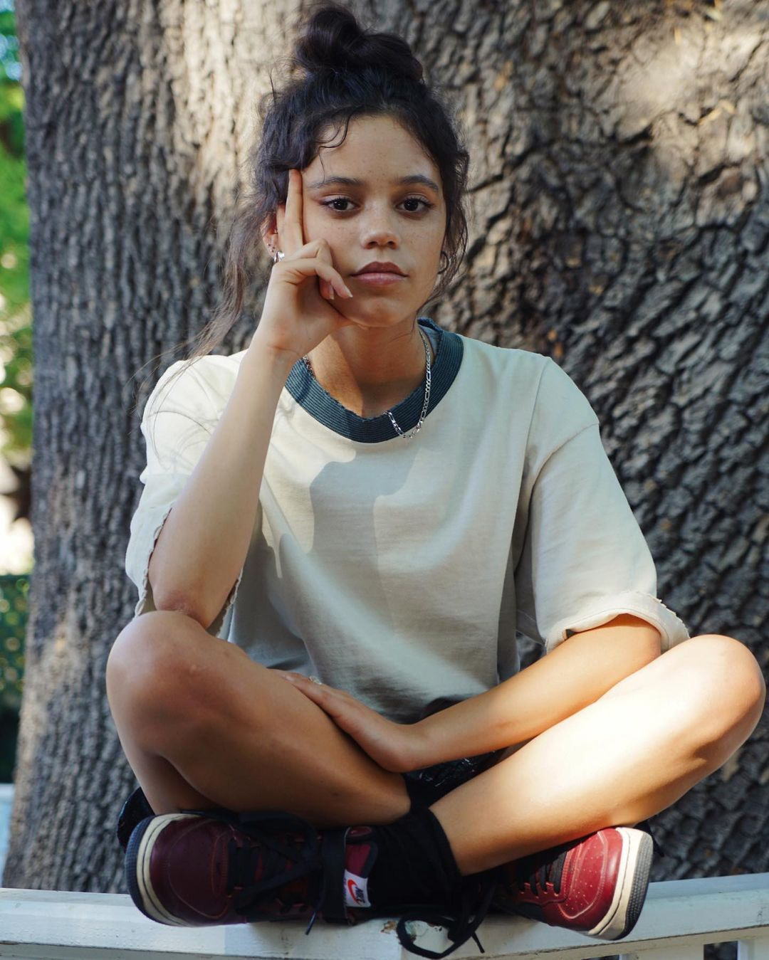 Jenna Ortega as Vada in The Fallout, wearing a white shirt and red trainers